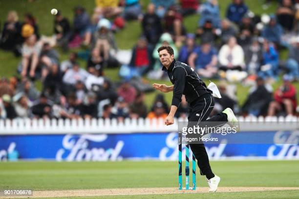 Mitchell Santner of New Zealand bowls during game one of the One Day International Series between the New Zealand Black Caps and Pakistan at Basin...