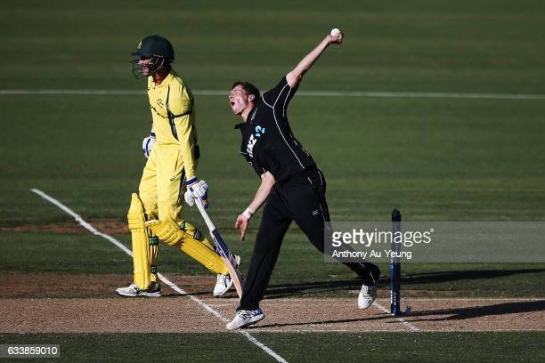 Mitchell Santner of New Zealand bowls during game three of the One Day International series between New Zealand and Australia at Seddon Park on...