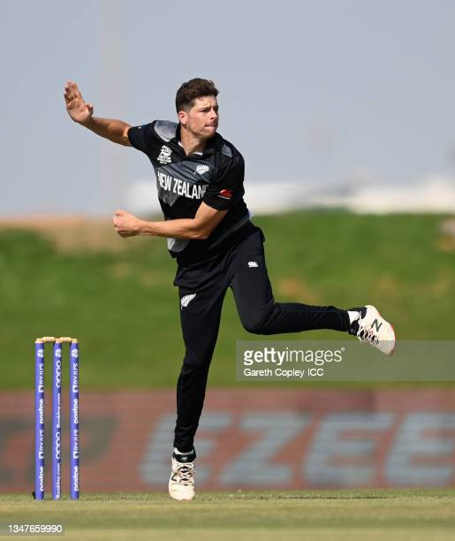 Mitchell Santner of New Zealand bowls during the England and New Zealand warm Up Match prior to the ICC Men's T20 World Cup at on October 20, 2021 in...
