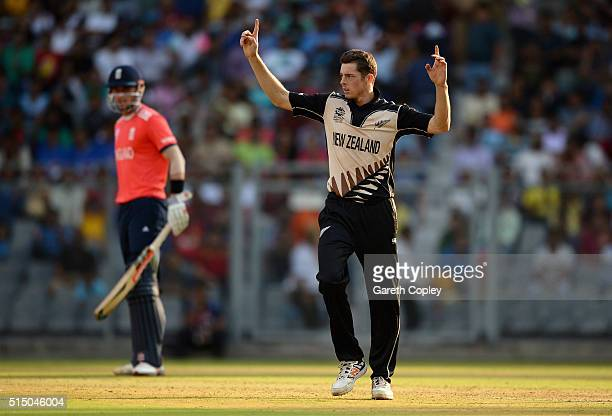 Mitchell Santner of New Zealand celebrates dismissing Joe Root of England during the ICC Twenty20 World Cup warm up match between New Zealand and...