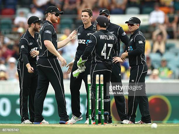 Mitchell Santner of New Zealand celebrates with team mates after taking the wicket of Aaron Finch of Australia during game two of the One Day...