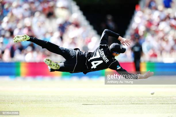 Mitchell Santner of New Zealand goes for a catch in mid air during game one in the One Day International series between New Zealand and England at...