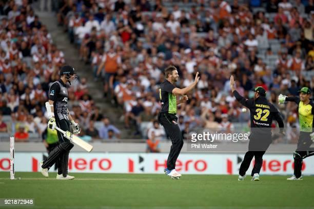 Mitchell Santner of New Zealand leaves the field as Andrew Tye of Australia celebrates his dismissal during the International Twenty20 Tri Series...