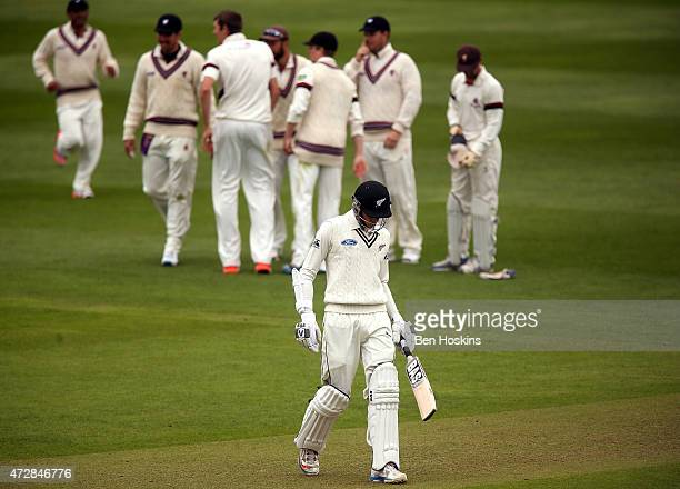 Mitchell Santner of New Zealand walks off after being dismissed during a tour match between Somerset and New Zealand at The County Ground on May 10...