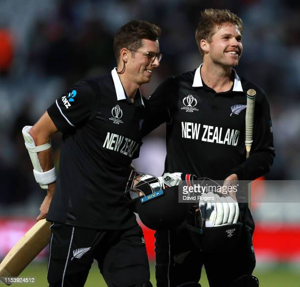 Mitchell Santner of New Zealand who scored the winning run celebrates with team mate Lockie Ferguson during the Group Stage match of the ICC Cricket...