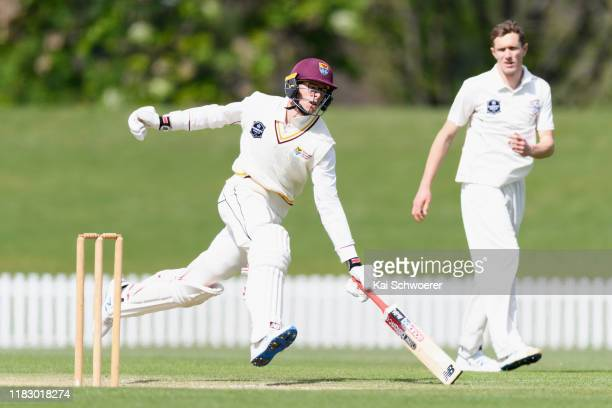 Mitchell Santner of Northern Districts dives to save his wicket during the Plunket Shield match between Canterbury and Northern Districts at Hagley...