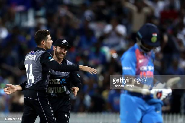 Mitchell Santner of the Black Caps celebrates the wicket of Shikhar Dhawan of India during the International T20 Game 3 between India and New Zealand...