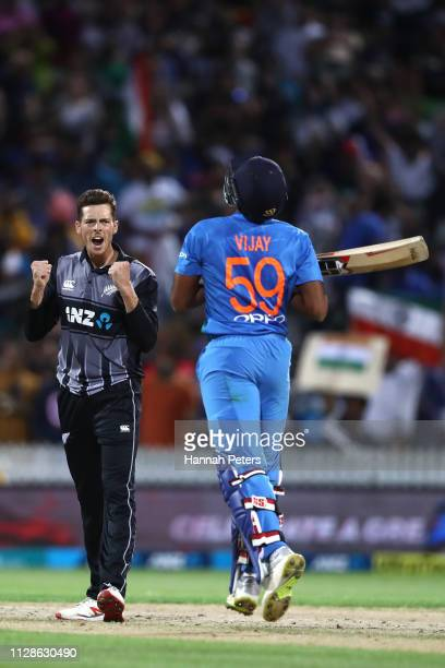 Mitchell Santner of the Black Caps celebrates the wicket of Vijay Shankar of India during the International T20 Game 3 between India and New Zealand...