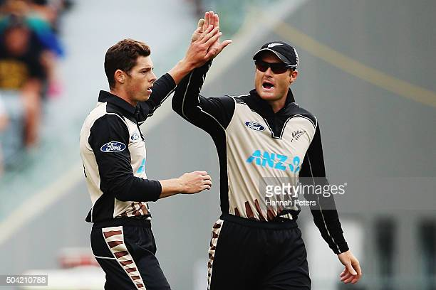 Mitchell Santner of the Black Caps celebrates with Martin Guptill of the Black Caps after claiming the wicket of Dinesh Chandimal of Sri Lanka during...