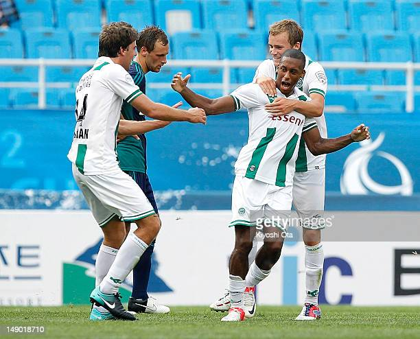 Mitchell Schet of FC Groningen celebrates his goal against Sunderland with team-mates during the Peace Cup 3rd place play-off match between...