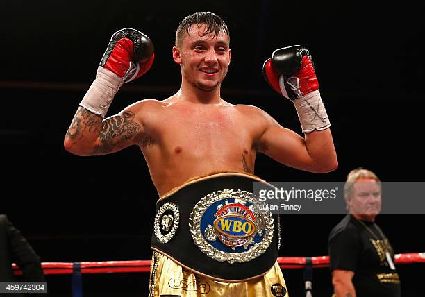Mitchell Smith of England celebrates defeating Zoltan Kovacs of Hungary in the vacant WBO european superfeatherweight championships during Boxing at...