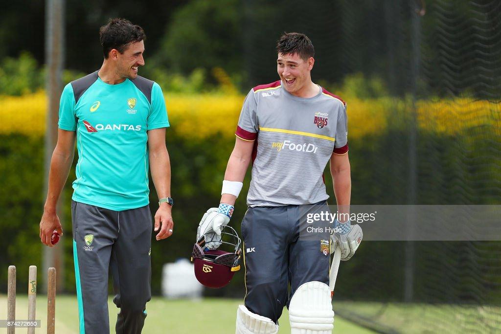 Mitchell Starc and Matthew Renshaw talk in the nets during an Australian cricket training session at Allan Border Field on November 15, 2017 in Brisbane, Australia.