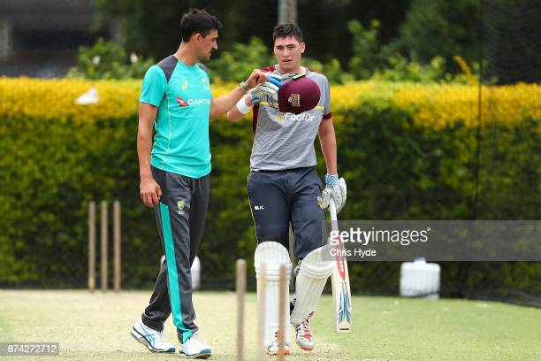 Mitchell Starc and Matthew Renshaw talk in the nets during an Australian cricket training session at Allan Border Field on November 15 2017 in...