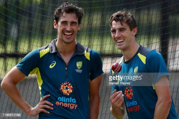 Mitchell Starc and Pat Cummins of Australia share a laugh during an Australia nets session at the Melbourne Cricket Ground on December 23, 2019 in...