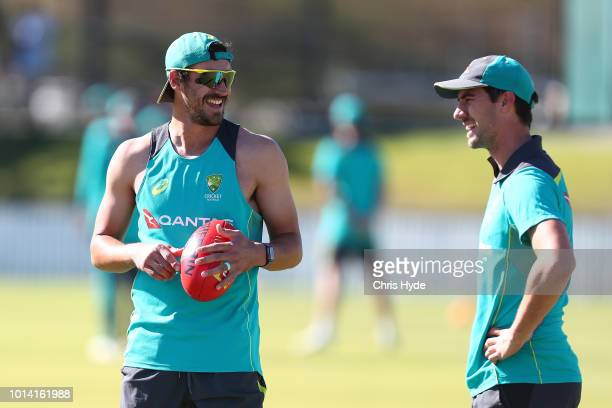 Mitchell Starc and Patrick Cummins during an Australia A training session at Allan Border Field on August 10 2018 in Brisbane Australia