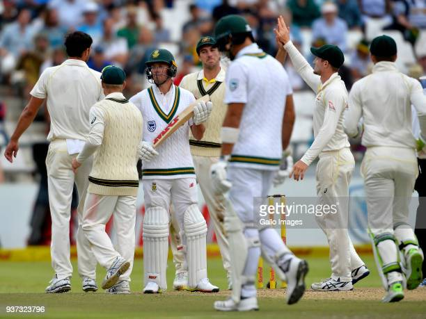 Mitchell Starc and team mates of Australia celebrate the wicket of Aiden Markram of South Africa during day 3 of the 3rd Sunfoil Test match between...