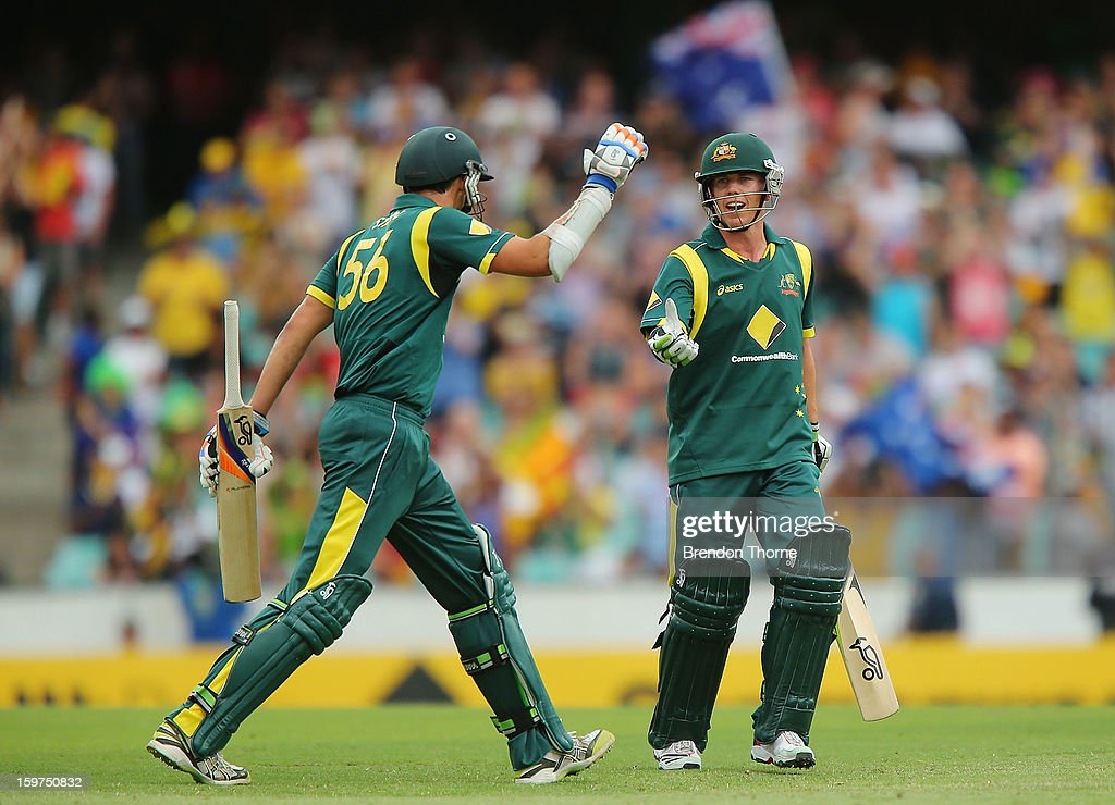 Mitchell Starc and Xavier Doherty of Australia celebrate after the Australian innings during game four of the Commonwealth Bank one day international series between Australia and Sri Lanka at Sydney Cricket Ground on January 20, 2013 in Sydney, Australia.