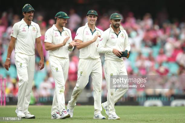 Mitchell Starc, James Pattinson, Pat Cummins and Nathan Lyon of Australia leave the field during day three of the Third Test match in the series...