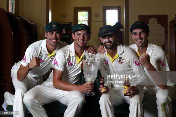 Mitchell Starc Josh Hazlewood Nathan Lyon and Pat Cummins of Australia celebrate with the Ashes Urn in the changreooms during day five of the Fifth...