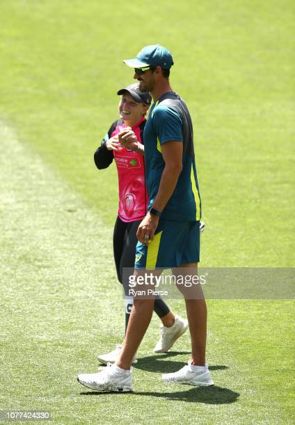 Mitchell Starc of Australia and his wife Alyssa Healy of Australia look on during an Australian training session at Adelaide Oval on December 05 2018...