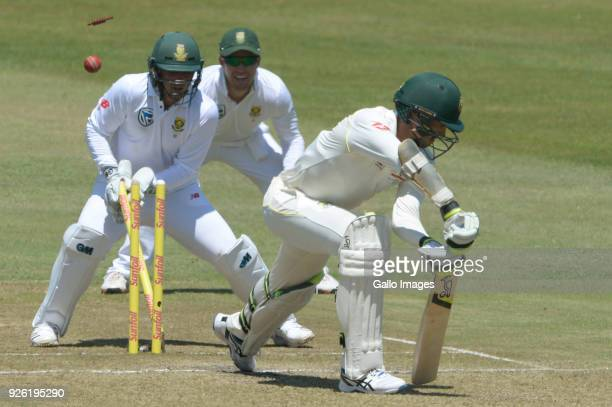 Mitchell Starc of Australia bowled by Keshav Maharaj of the Proteas during day 2 of the 1st Sunfoil Test match between South Africa and Australia at...