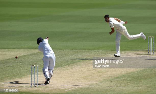 Mitchell Starc of Australia bowls Dimuth Karunaratne of Sri Lanka during day four of the Second Test match between Australia and Sri Lanka at Manuka...