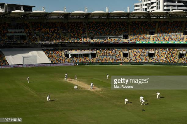 Mitchell Starc of Australia bowls during day five of the 4th Test Match in the series between Australia and India at The Gabba on January 19, 2021 in...