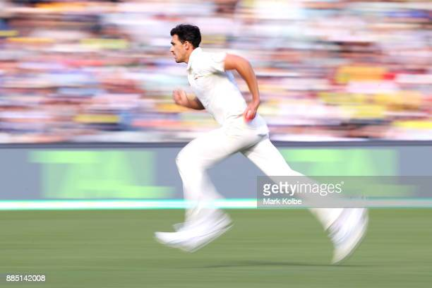 Mitchell Starc of Australia bowls during day three of the Second Test match during the 2017/18 Ashes Series between Australia and England at Adelaide...