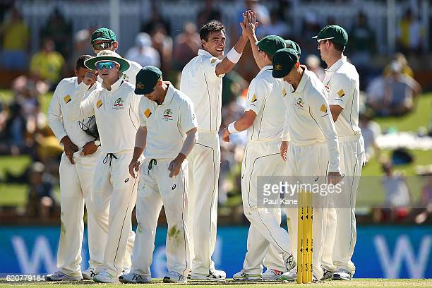 Mitchell Starc of Australia celebrate sthe wicket of Vernon Philander of South Africa during day one of the First Test match between Australia and...