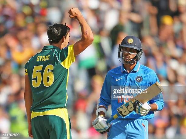 Mitchell Starc of Australia celebrates after dismissing Akshar Patel of India during the One Day International match between Australia and India at...