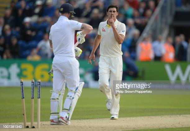 Mitchell Starc of Australia celebrates after dismissing Ben Stokes of England for 52 runs during the 1st Ashes Test match between England and...