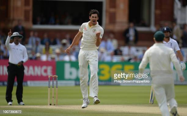 Mitchell Starc of Australia celebrates after dismissing England opener Adam Lyth for 7 runs during the 2nd Ashes Test match between England and...
