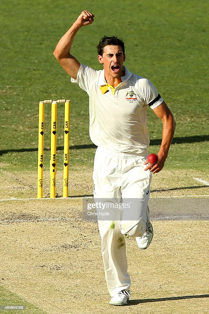 Mitchell Starc of Australia celebrates after dismissing Murali Vijay of India during day three of the 2nd Test match between Australia and India at The Gabba on December 19, 2014 in Brisbane, Australia.