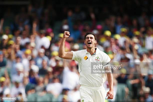 Mitchell Starc of Australia celebrates after getting the wicket of Brendon McCullum of New Zealand during day one of the Third Test match between...