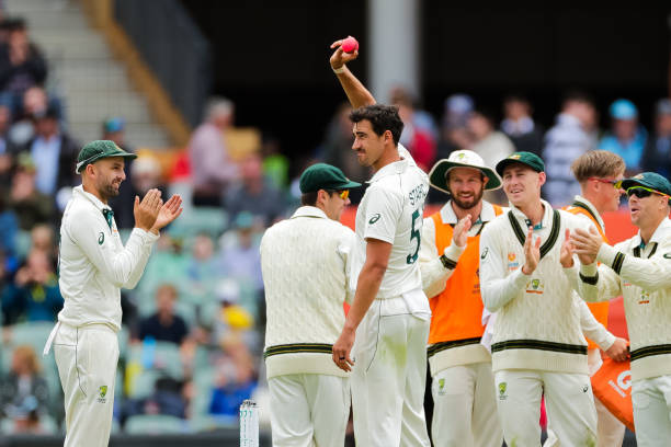 Mitchell Starc of Australia celebrates after taking five wickets in an innings during day 3 at Adelaide Oval on December 01 2019 in Adelaide Australia