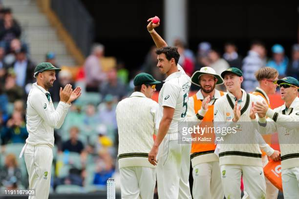 Mitchell Starc of Australia celebrates after taking five wickets in an innings during day 3 at Adelaide Oval on December 01, 2019 in Adelaide,...