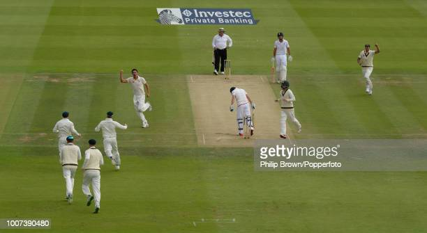 Mitchell Starc of Australia celebrates after taking the wicket of England opener Adam Lyth caught by Australia's wicketkeeper Peter Nevill for 0...
