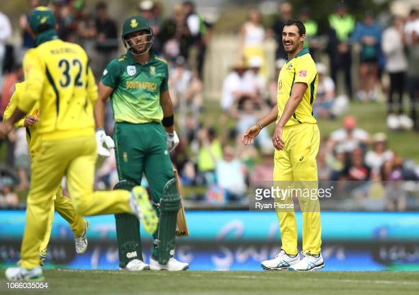 Mitchell Starc of Australia celebrates after taking the wicket of Aiden Markram of South Africa during game three of the One Day International series...