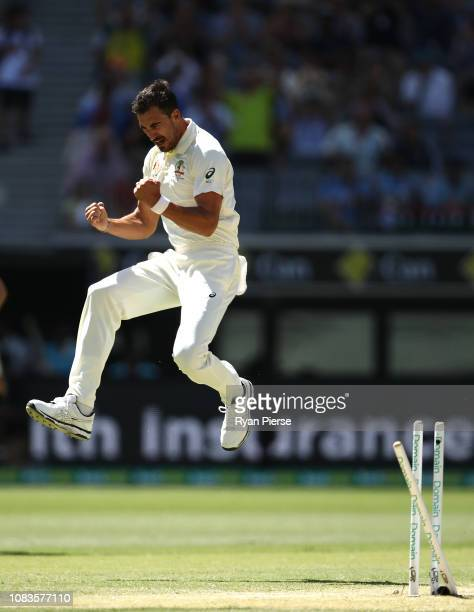 Mitchell Starc of Australia celebrates after taking the wicket of Lokesh Rahul of India during day four of the second match in the Test series...