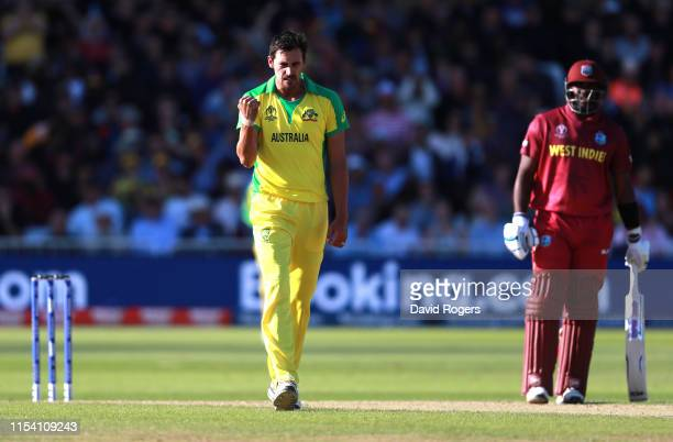 Mitchell Starc of Australia celebrates after taking the wicket of Jason Holder during the Group Stage match of the ICC Cricket World Cup 2019 between...