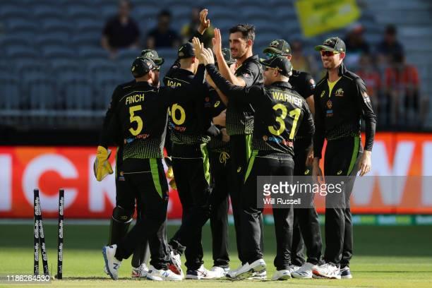 Mitchell Starc of Australia celebrates after taking the wicket Mohammad Rizwan of Pakistan of Pakistan of Pakistan during game three of the...