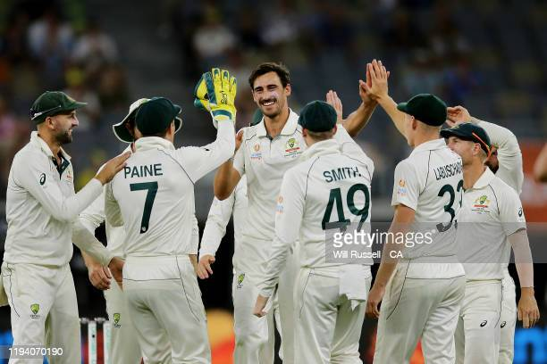 Mitchell Starc of Australia celebrates after taking the wicket of Neil Wagner of New Zealand during day four of the First Test match in the series...