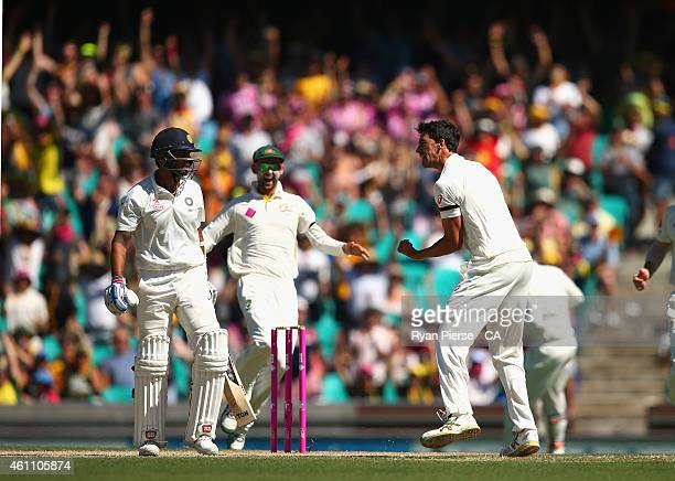 Mitchell Starc of Australia celebrates after taking the wicket of Murali Vijay of India during day two of the Fourth Test match between Australia and...