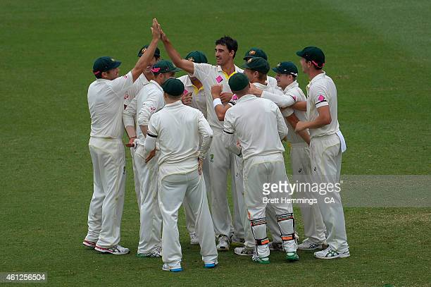 Mitchell Starc of Australia celebrates after taking the wicket of Virat Kohli of India during day five of the Fourth Test match between Australia and...