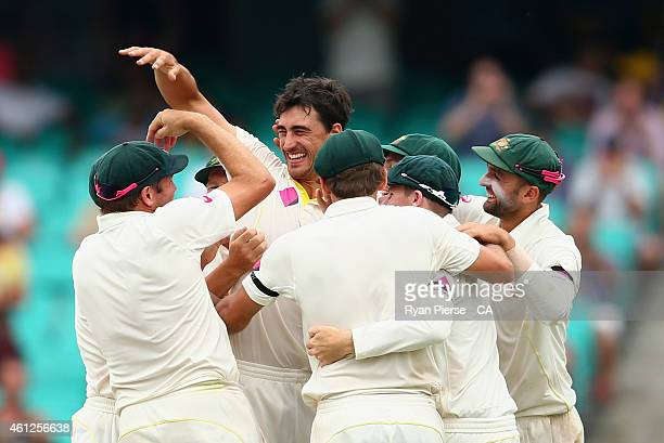 Mitchell Starc of Australia celebrates after taking the wicket of Suresh Raina of India during day five of the Fourth Test match between Australia...