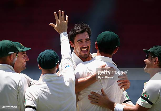 Mitchell Starc of Australia celebrates after taking the wicket of Marlon Samuels of West Indies during day one of the First Test match between...