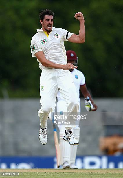 Mitchell Starc of Australia celebrates after taking the wicket of Kraigg Brathwaite of West Indies during day two of the First Test match between...