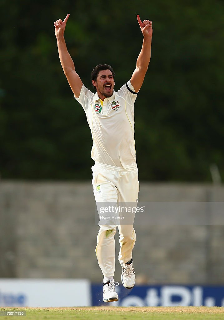 Mitchell Starc of Australia celebrates after taking the wicket of Devendra Bishoo of West Indies during day three of the First Test match between Australia and the West Indies at Windsor Park on June 5, 2015 in Roseau, Dominica.