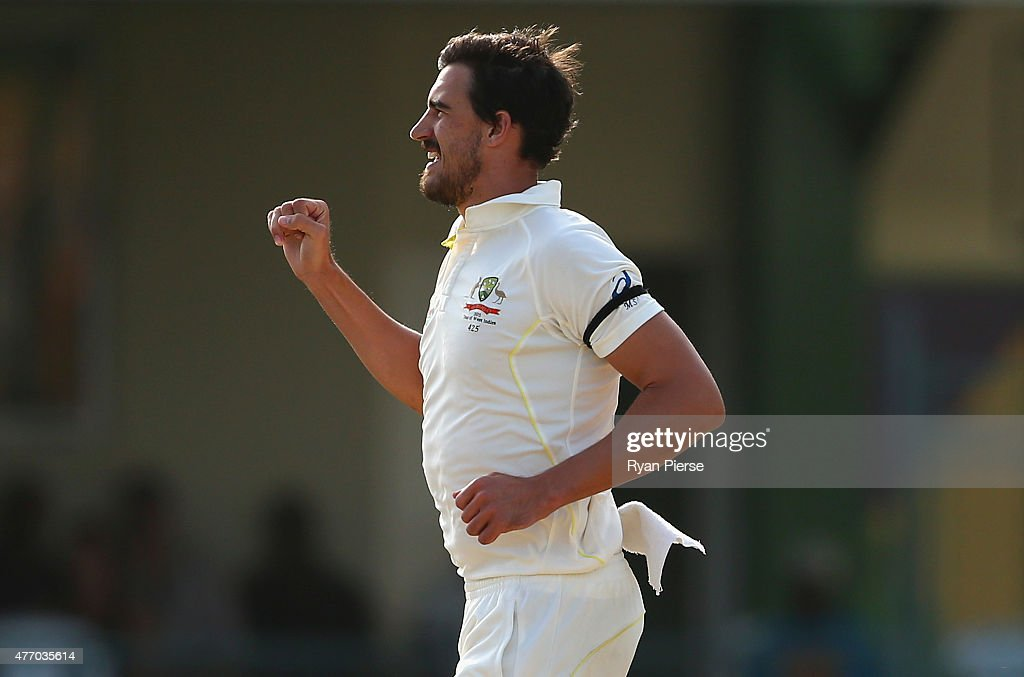 Mitchell Starc of Australia celebrates after taking the wicket of Rajendra Chandrika of West Indies during day three of the Second Test match between Australia and the West Indies at Sabina Park on June 13, 2015 in Kingston, Jamaica.