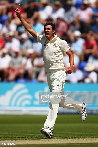 Mitchell Starc of Australia celebrates after taking the wicket of Alastair Cook of England during day three of the 1st Investec Ashes Test match...